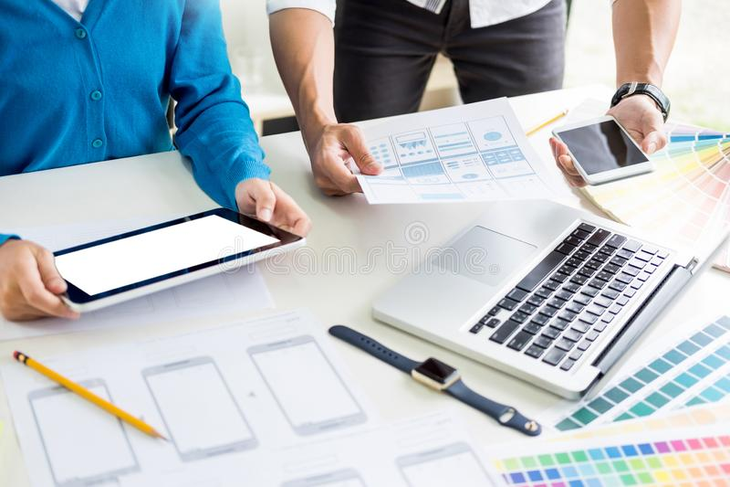 Creative or Interior designers teamwork with pantone swatch and building plans on office desk, architects choosing color samples royalty free stock images