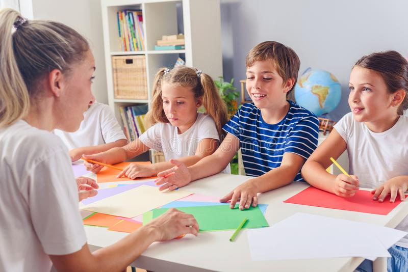 Mother or school teacher with children. Creative arts and crafts project at school or at home. Creative kids. Creative Arts and Crafts Classes in After School stock image