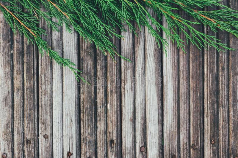Creative layout frame made of Christmas fir branches on wooden background. Flat lay, top view royalty free stock photography