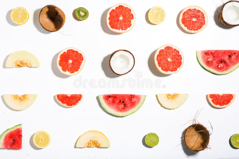 Creative layout made pineapple, watermelon, coconut, melon, grapefruit, lemon, kiwi stock images