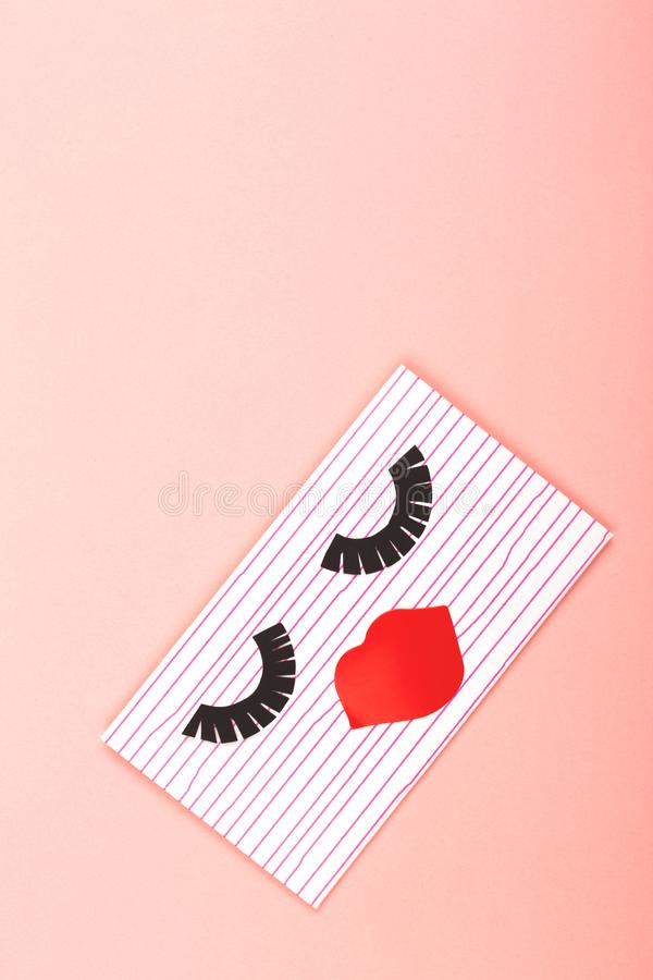 Envelope on pink background. Creative love or Valentine day background made with cute envelope. Eye lashes and red lips looklike a woman face. Love letter or royalty free stock photos