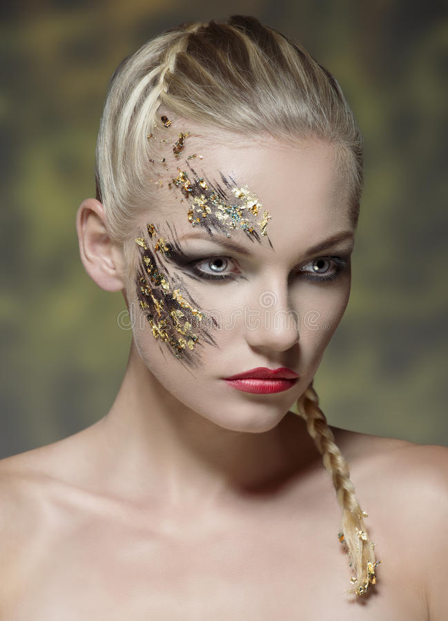 Creative make-up on female visage stock photos