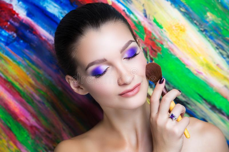 Woman art make up. Creative make-up new conceptual idea. colorful bold faceart body art painting. Crazy new graphic abstract picture, woman face surrealistic royalty free stock photography