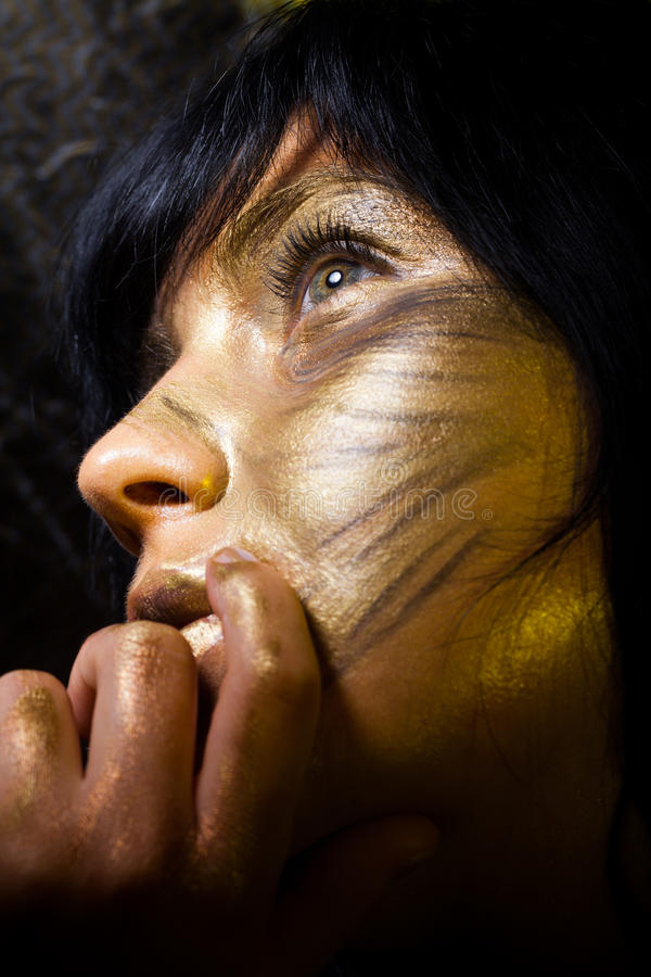 Creative make-up. Technique: golden paint stock image
