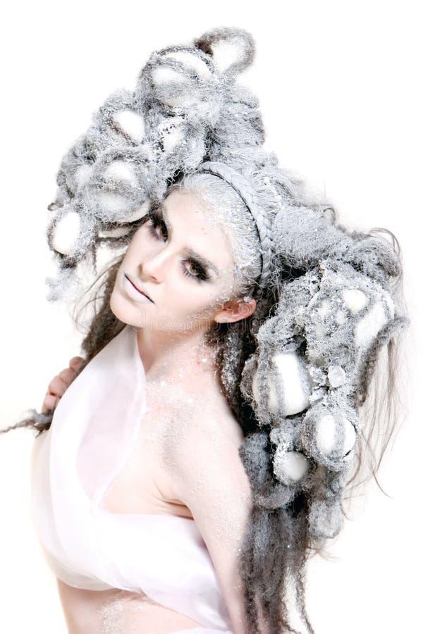 Creative makeup and hair on a fashion girl stock image