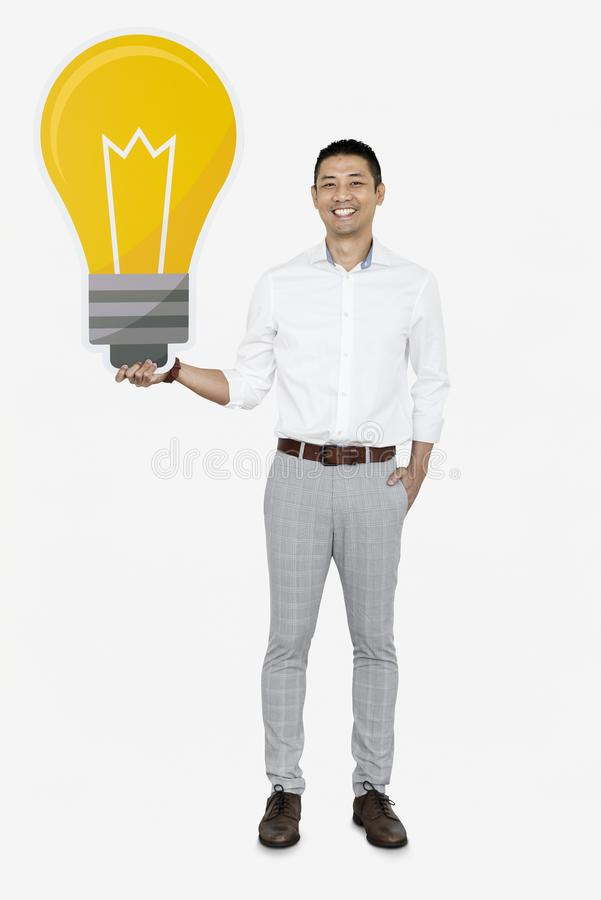 Creative man showing a light bulb icon stock images