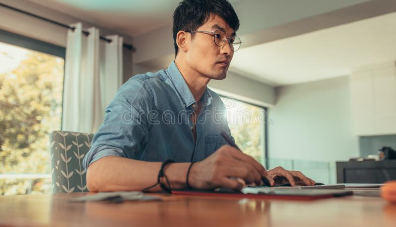 Professional architect working at his desk stock images
