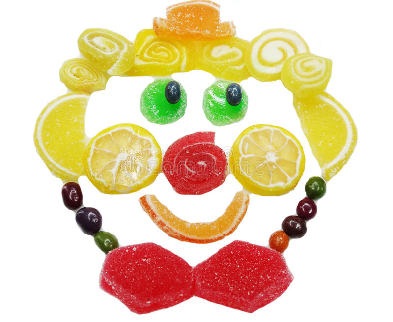 Creative marmalade fruit jelly sweet food clown face form royalty free stock photo
