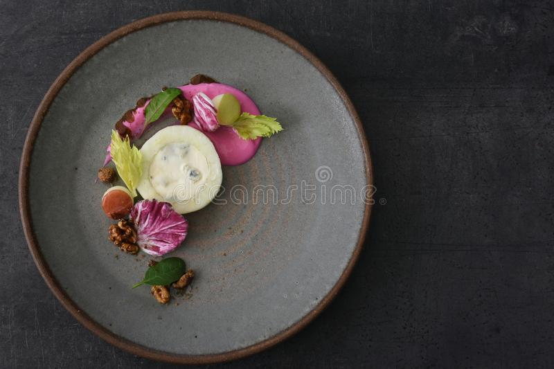 Creative Meal on Handmade Plate in Fine Dining Restaurant royalty free stock photography