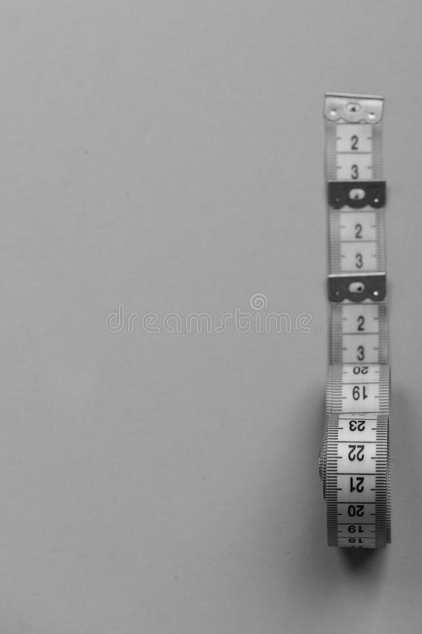 Creative measurements idea. Tape measures of cyan, blue, yellow colors. Creative measurements idea. Tape measures of cyan, blue and yellow colors placed in row royalty free stock image