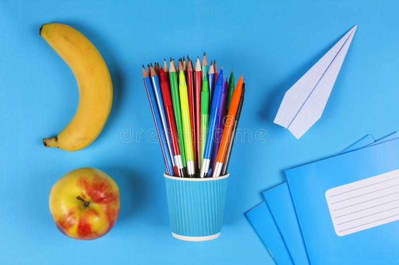 Creative, minimalistic style. Back to school concept. school snack, School, office supplies, banana, apple, Flat lay with copy spa stock images