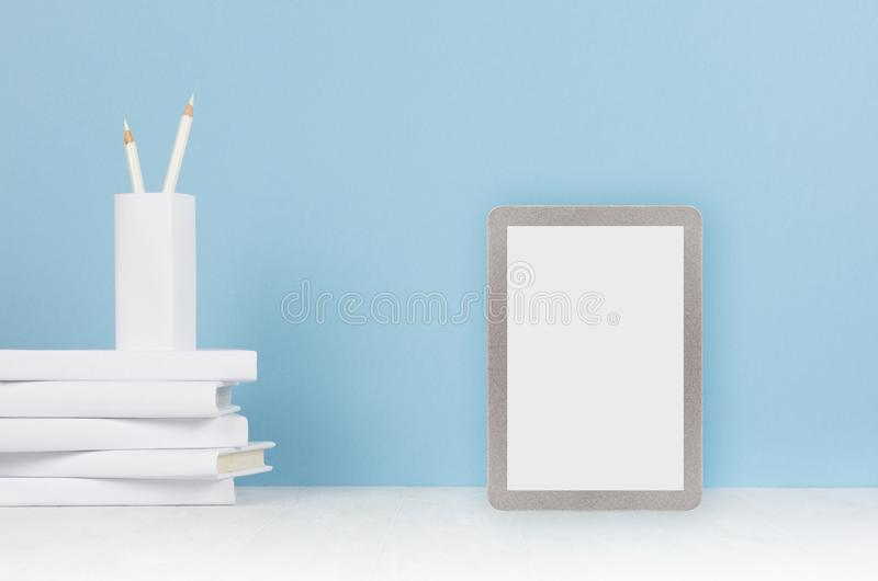 Creative mock up back to school - white stationery, blank tablet touch computer on soft blue background. stock image