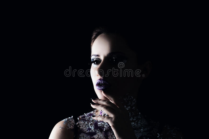 Creative Model Woman with Art Makeup and Silver Skin royalty free stock photos