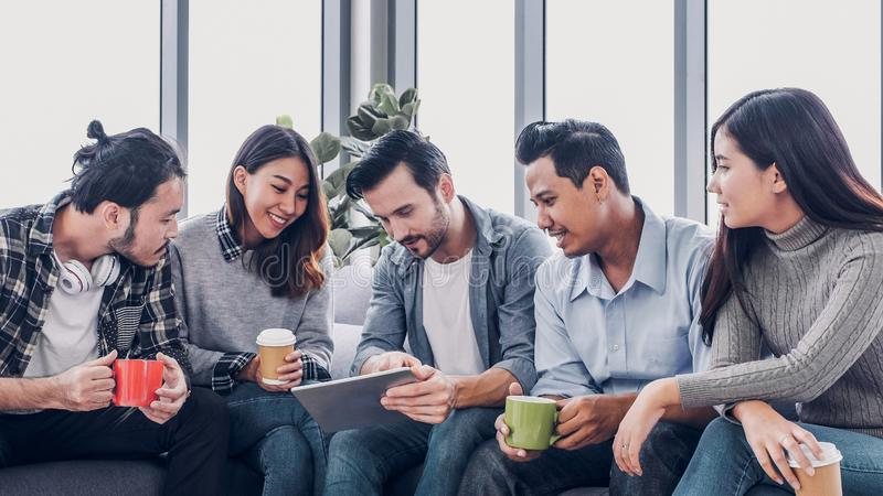 Creative office,Designer team use tablet in casual meeting at sofa and got a good idea for project.  royalty free stock images