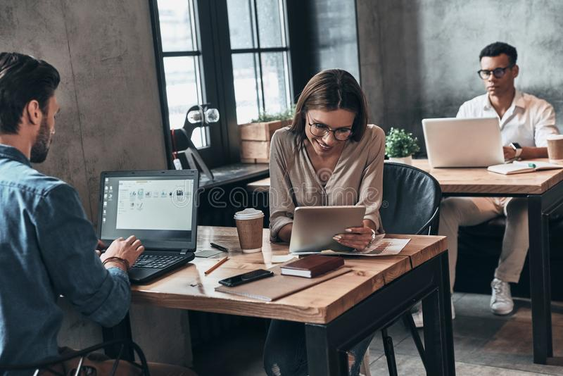 Creative office. Young modern people in smart casual wear concen. Trating at work while spending time in the office royalty free stock photos