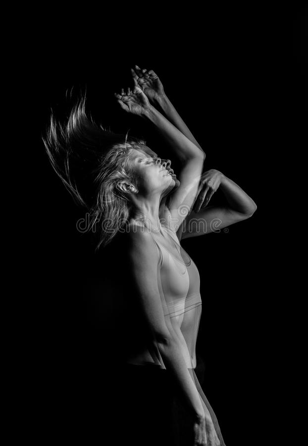 Creative original portrait of the girl throws up her hair. movement effecttriple Multiple exposure black and white photo royalty free stock photo