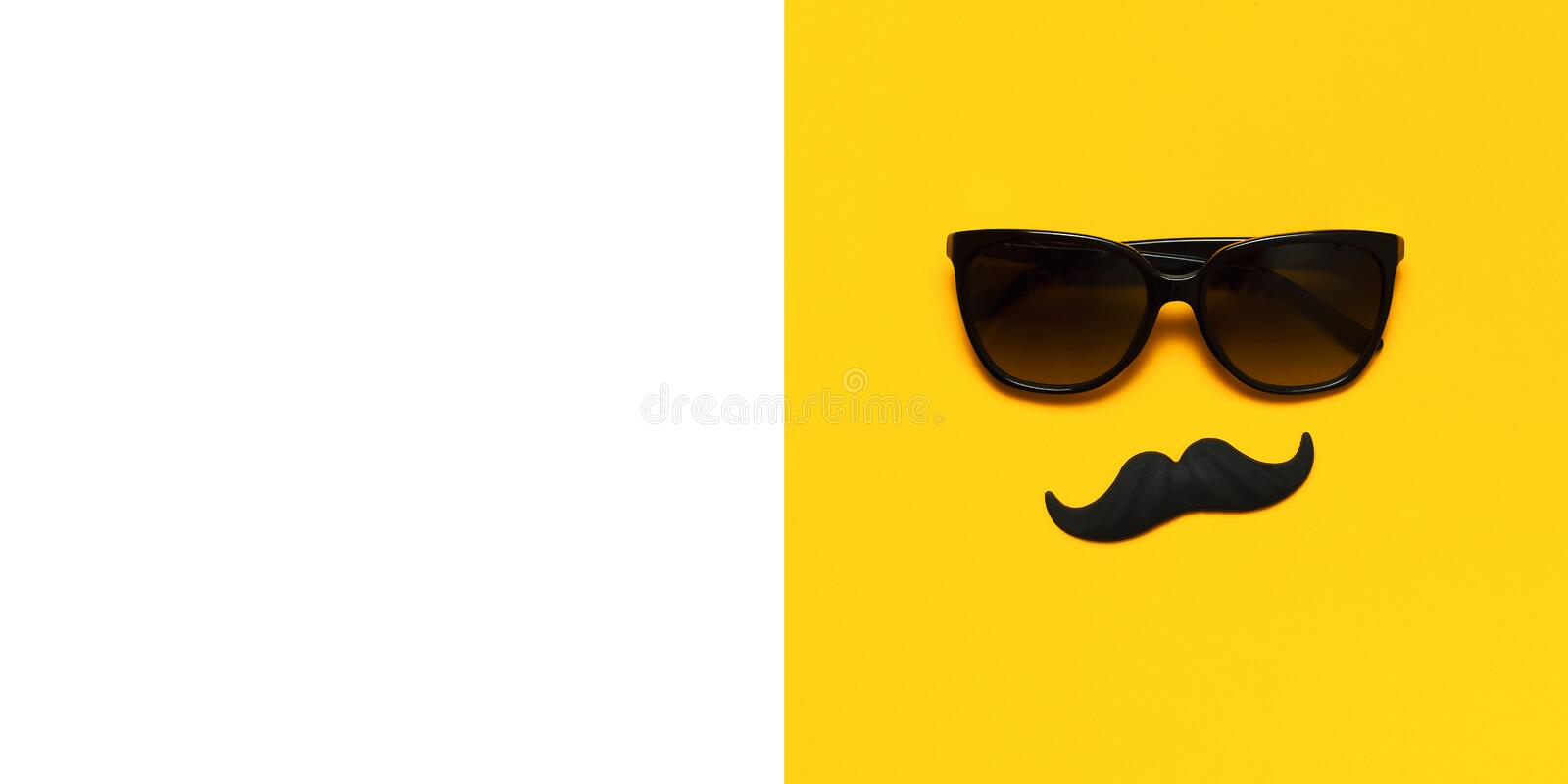Creative party decoration concept. Black mustache, sunglasses, props for photo booths, carnival parties on yellow background top royalty free stock photography