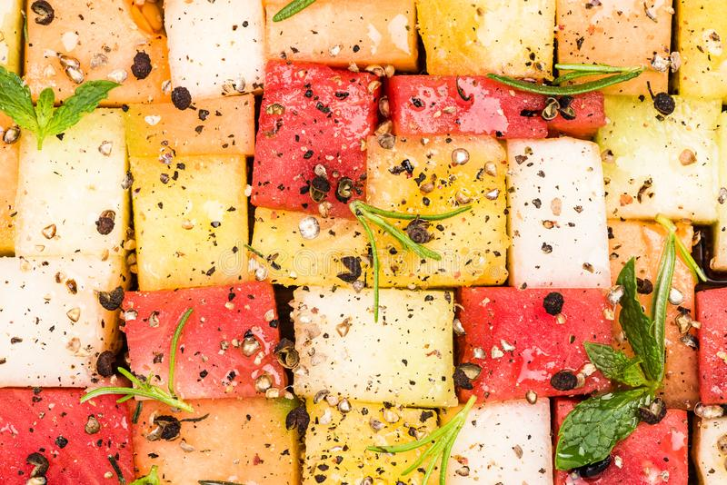 Creative Party Food, Melon and Watermelon Cubes with HErbs and Spices stock photos