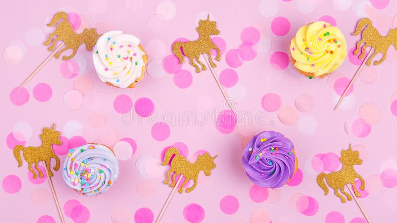 Creative pastel fantasy holiday card with cupcake, confetti and. Unicorn. Baby shower, birthday, celebration concept. Horizontal, banner, wide screen format royalty free stock photo