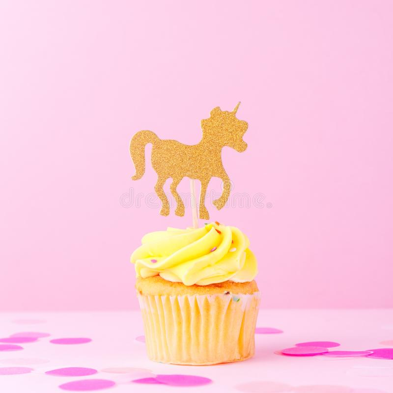 Creative pastel fantasy holiday card with cupcake, confetti and. Unicorn. Baby shower, birthday, celebration concept. Square royalty free stock image