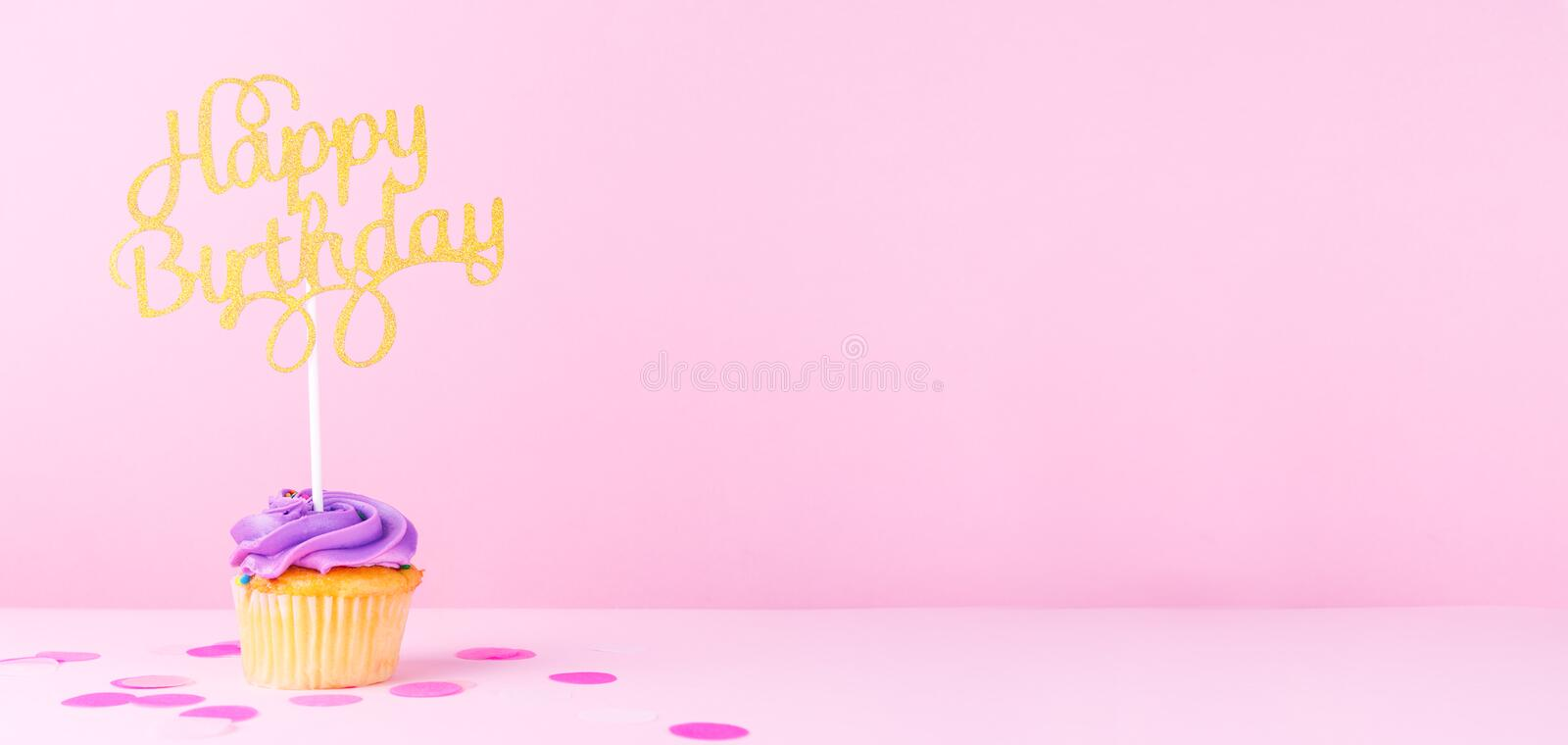Creative pastel fantasy holiday card with cupcake and happy birthday topper. Baby shower, birthday, celebration concept. Horizontal, wide screen banner format royalty free stock photography