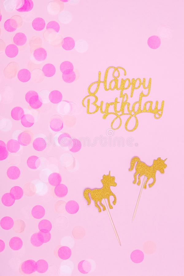 Creative pastel fantasy holiday card with cupcake, happy birthday lettering and unicorn. Baby shower, birthday, celebration. Concept. Vertical royalty free stock images