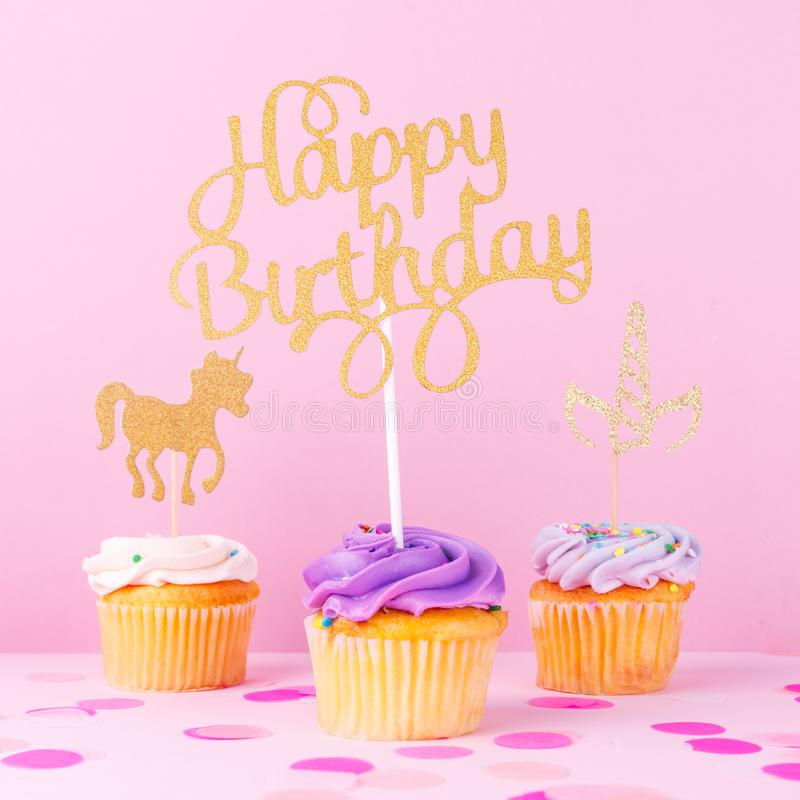 Creative pastel fantasy holiday card with cupcake, happy birthday lettering and unicorn. Baby shower, birthday, celebration. Concept. Square royalty free stock image
