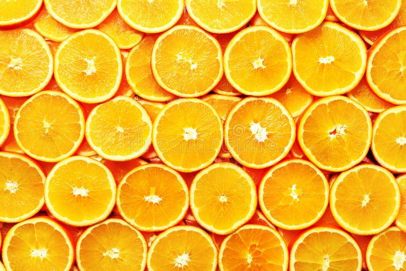 Creative pattern. Fresh sliced orange fruit texture. Macro, top view with copy space. Food frame. Juicy oranges royalty free stock photo