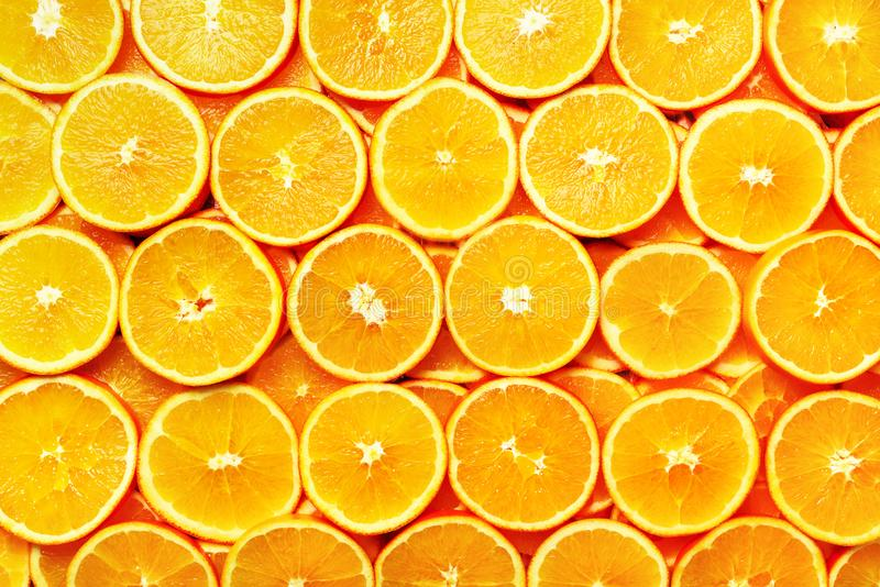 Creative pattern. Fresh sliced orange fruit texture. Macro, top view with copy space. Food frame. Juicy oranges stock photos