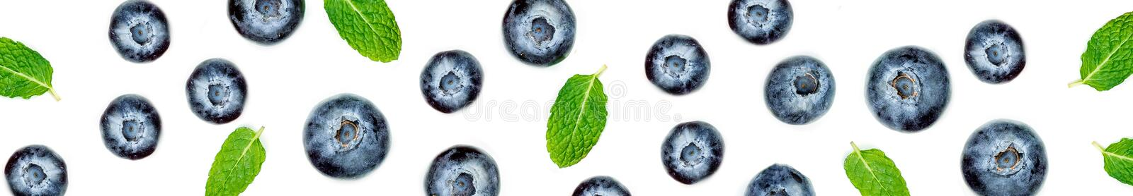 Creative pattern made of blueberries with leaves. Fresh berry f stock photo