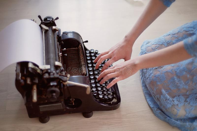 A creative person, author of books, writer of bestsellers,a journalist typing on an old typewriter. Inspiration in the stock images
