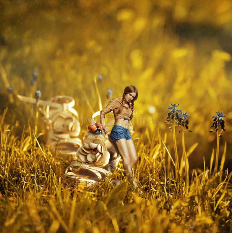 Creative photo manipulation with girl near the giant shoe royalty free stock photos