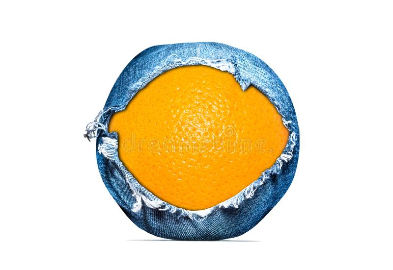 Creative photo of an orange close-up in a denim shell with a hole in a denim texture isolated on a white background. Abstract apple photo in jeans texture stock image