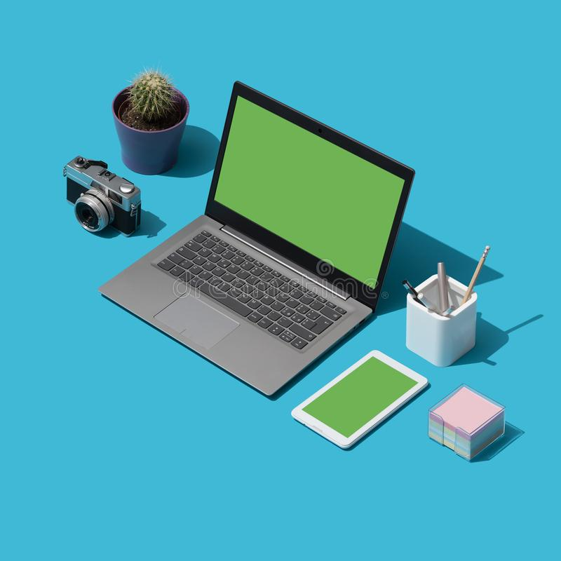 Creative photographer and designer desktop. With laptop and digital camera, isometric objects royalty free illustration