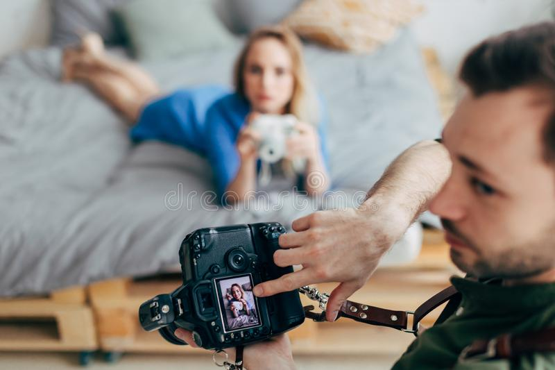 Creative photographer pointing at the screen of the camera royalty free stock photo