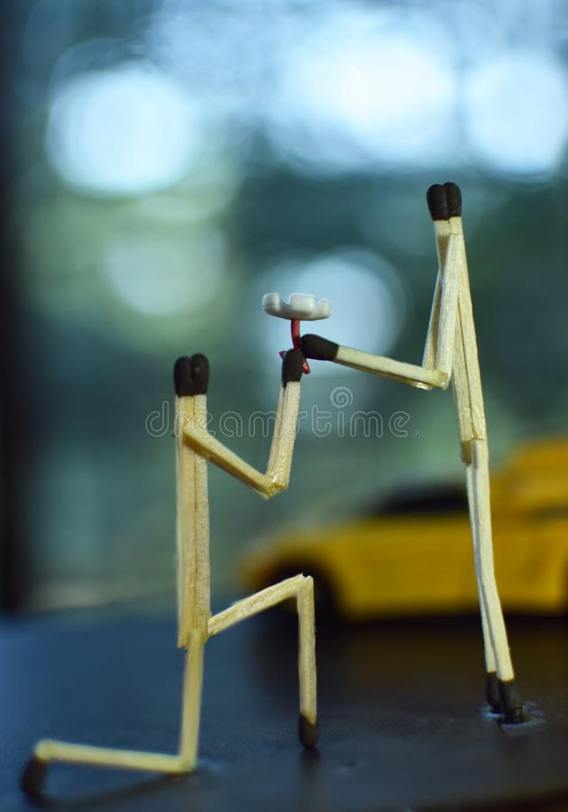Creative Photography of boy propose to girl with Flower using Matches Stick stock photo