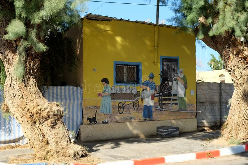 Creative placemaking. Artists paint pictures on the walls of old houses stock photo