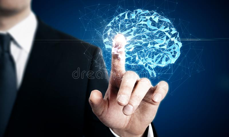 Creative polygonal brain. Businessman pointing at creative glowing polygonal brain on blue background. AI and future concept. Double exposure royalty free stock photos