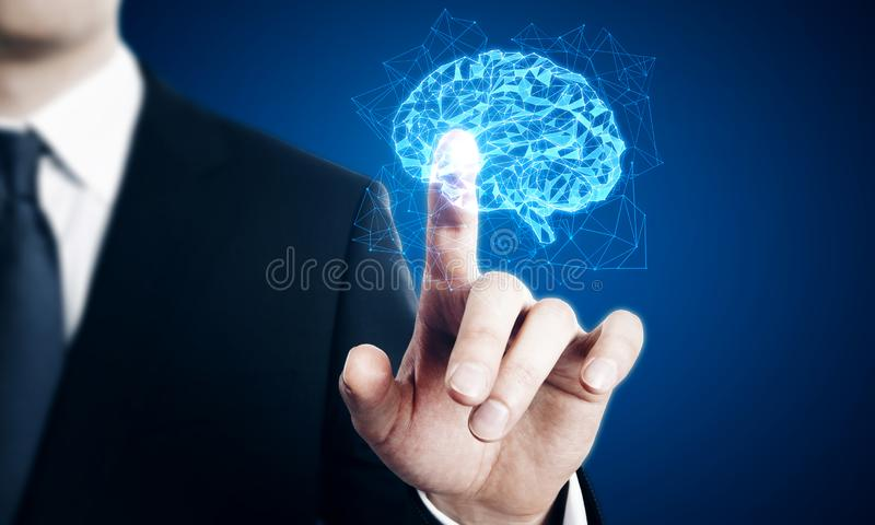 Creative polygonal brain. Businessman pointing at creative glowing polygonal brain on blue background. AI and future concept. Multiexposure royalty free stock photography