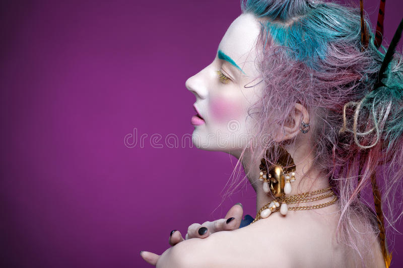 Creative portrait of young woman with artistic make-up. royalty free stock photography