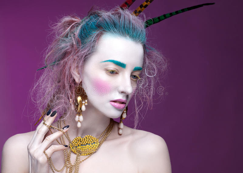 Creative portrait of young woman with artistic make-up. royalty free stock photos