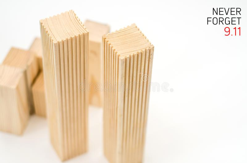 Creative poster in honor of September 9, skyscrapers of the World Trade Center carved wood breadboard models. Memory of the attack royalty free stock photos