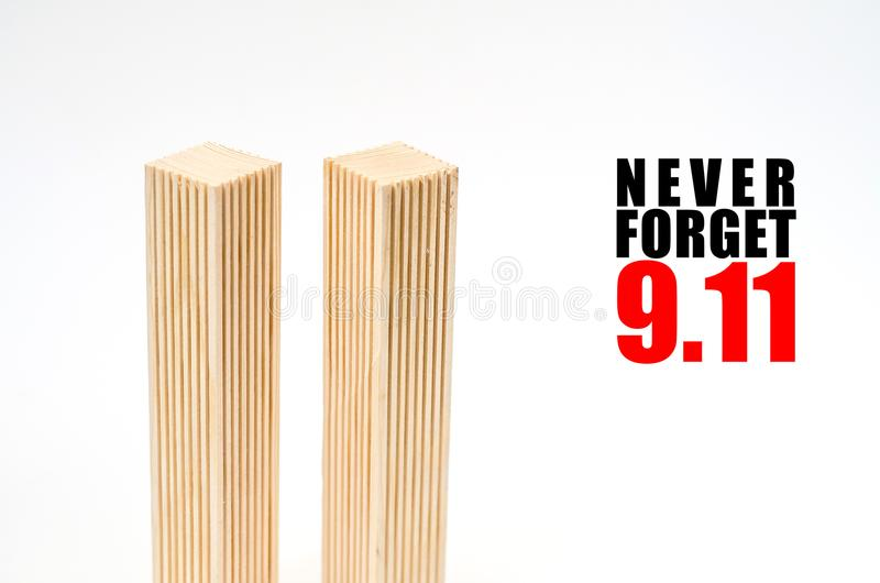 Creative poster in honor of September 9, skyscrapers of the World Trade Center carved wood breadboard models. Memory of the attack stock photography