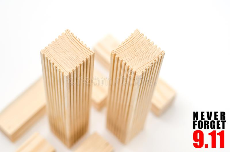 Creative poster in honor of September 9, skyscrapers of the World Trade Center carved wood breadboard models. Memory of the attack. Creative poster honor of royalty free stock image