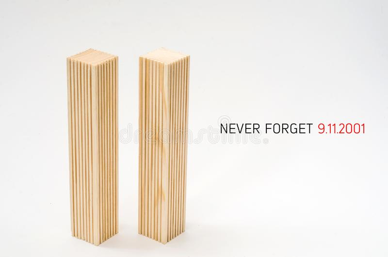 Creative poster in honor of September 9, skyscrapers of the World Trade Center carved wood breadboard models. Memory of the attack. Creative poster honor of stock images