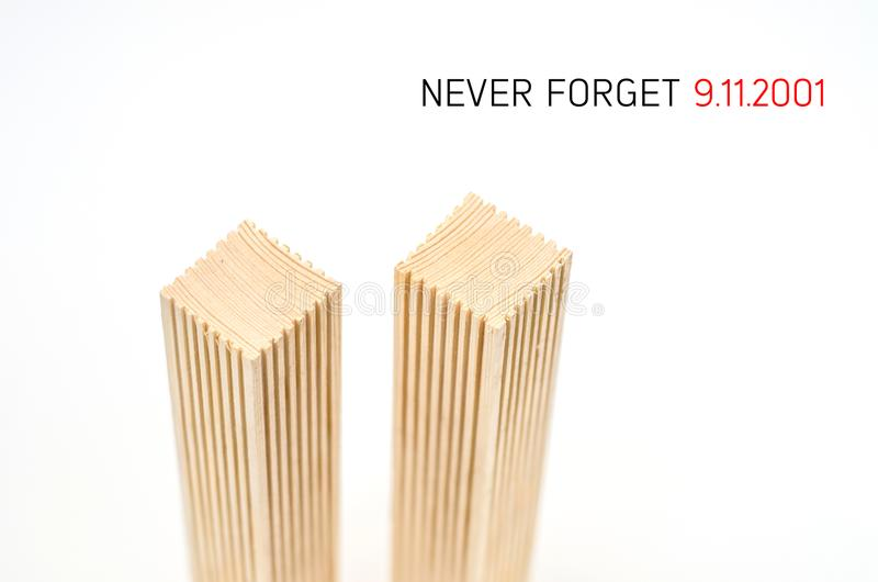 Creative poster in honor of September 9, skyscrapers of the World Trade Center carved wood breadboard models. Memory of the attack stock image