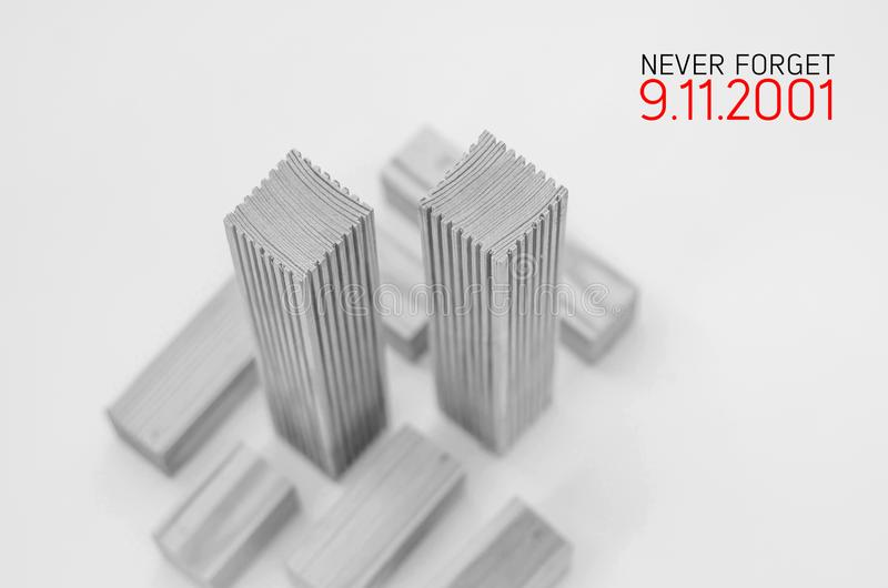 Creative poster in honor of September 9, skyscrapers of the World Trade Center carved wood breadboard models. Memory of the attack. Creative poster honor of royalty free stock images