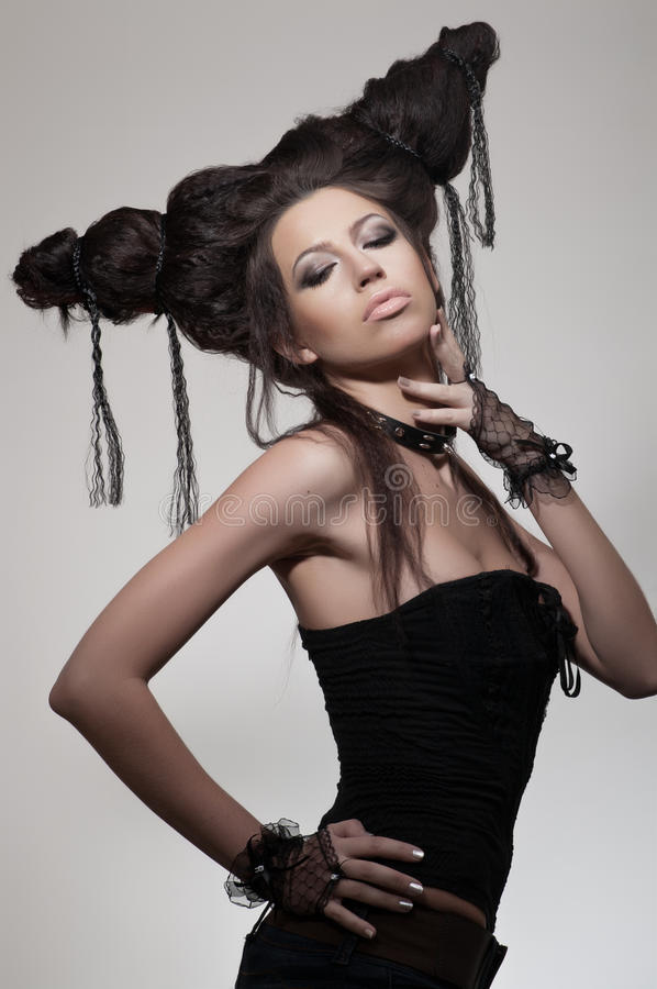 Creative potrait of woman with hairstyle. Creative potrait of woman in gloves with hairstyle stock photos