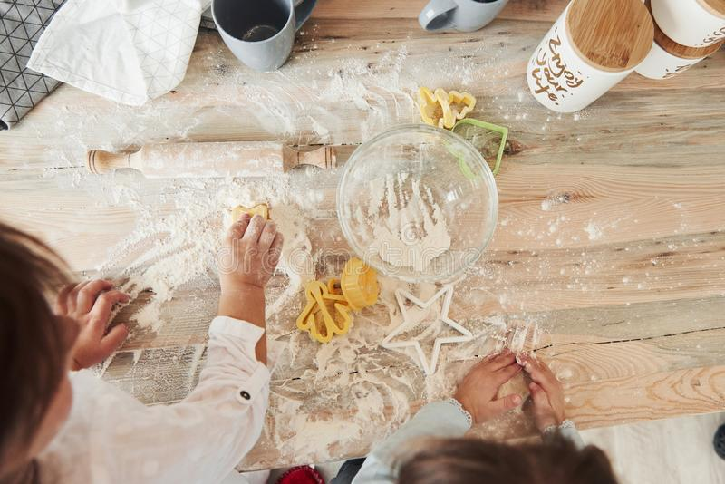 Creative process. Top view of kids learning to prepare food from the flour with special formed instruments stock photo