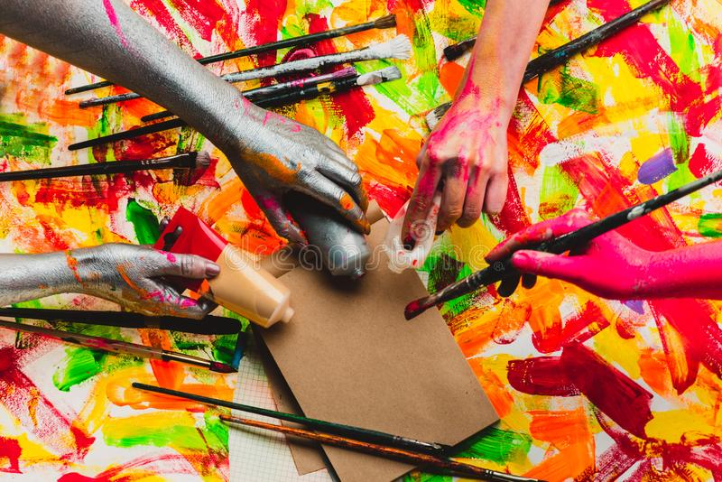 Creative project. Beautiful background. Art. The collective. Teambuilding. Four colored hands. Multi-color photo stock image